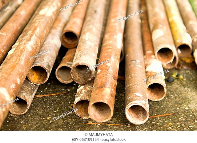 Metal new pipes are stored at the factory warehouse. From storage rust