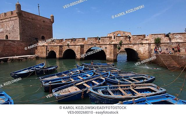 Blue boats in the harbor of Essaouira, Morocco on May 07, 2013. The old medina is declared UNESCO World Heritage Site