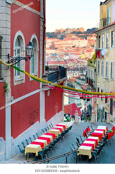Old Town street with outdoor restaurant. Lisbon, Portugal