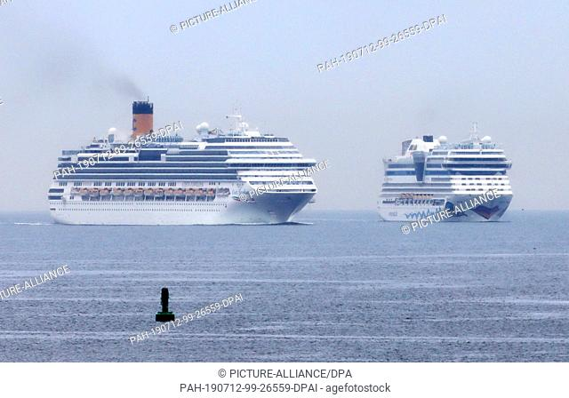 """12 July 2019, Mecklenburg-Western Pomerania, Rostock: On the Baltic Sea off Warnemünde the cruise ships """"""""Costa Favolosa"""""""" (l-r) and """"""""Aidamar"""""""" set course for..."""