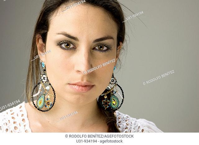 Latin woman with big brown eyes looking at the camera