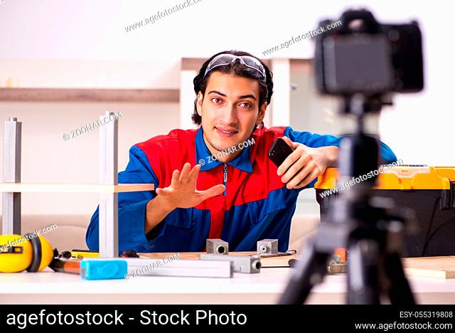 Young contractor recording video for his blog