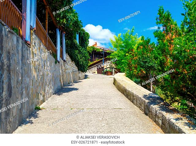 Ancient narrow street in the historic tourist town. Sidewalk in the old town of Nessebar in Bulgaria