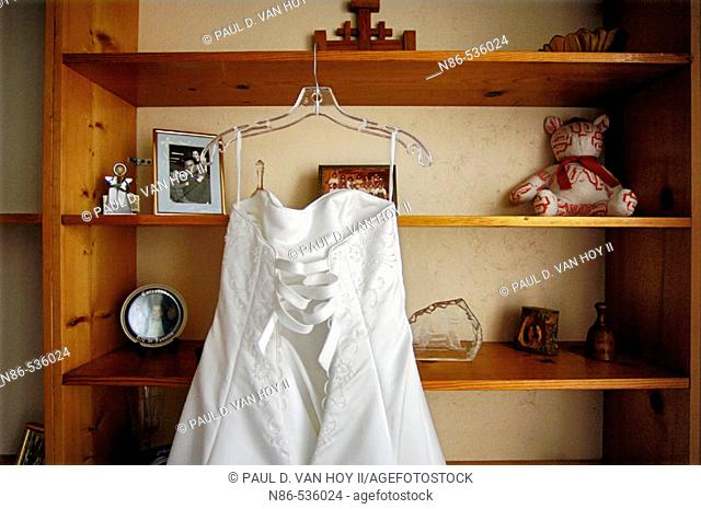 Bridal gown hanging on shelves