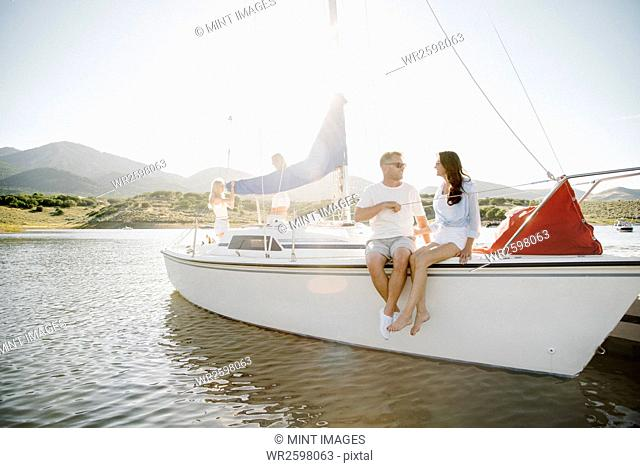 Man and woman sitting on a sail boat
