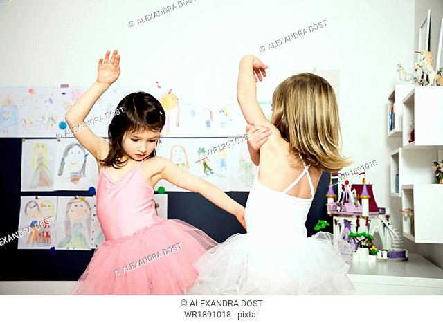 Two little ballerinas exercising together
