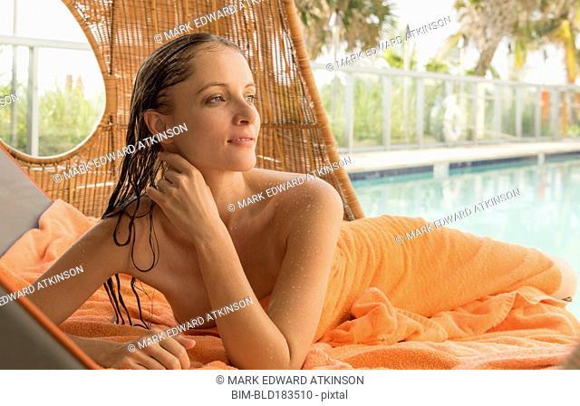 Caucasian woman relaxing in cabana