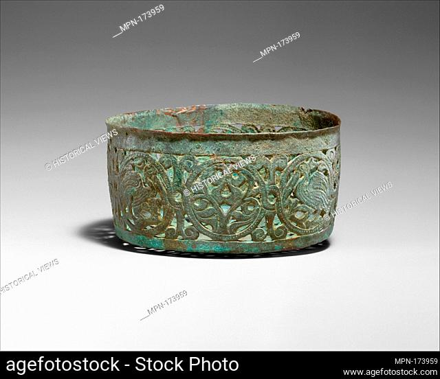 Vessel with Pierced Designs. Object Name: Basin; Date: ca. 700; Geography: Attributed to Syria; Medium: Bronze; pierced and chased; Dimensions: H