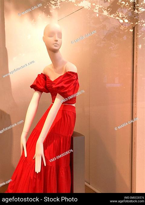 Mannequin wearing red dress in a shop window. Madrid, Spain
