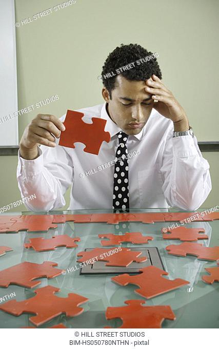 Businessman with jigsaw puzzle