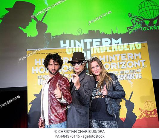 "Musician Udo Lindenberg (c), Serkan Kaya (l) who plays Udo Lindenberg, and Josephin Busch, who plays Jessy the """"girl from East Berlin (r)"