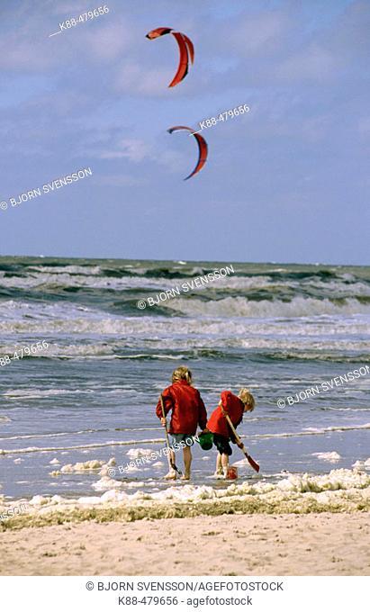 Children playing on beach, Noordwijk. Holland