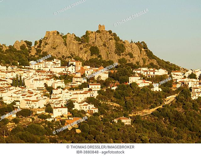 The White Town of Gaucín below a Moorish fort, in the evening light, Málaga province, Andalusia, Spain