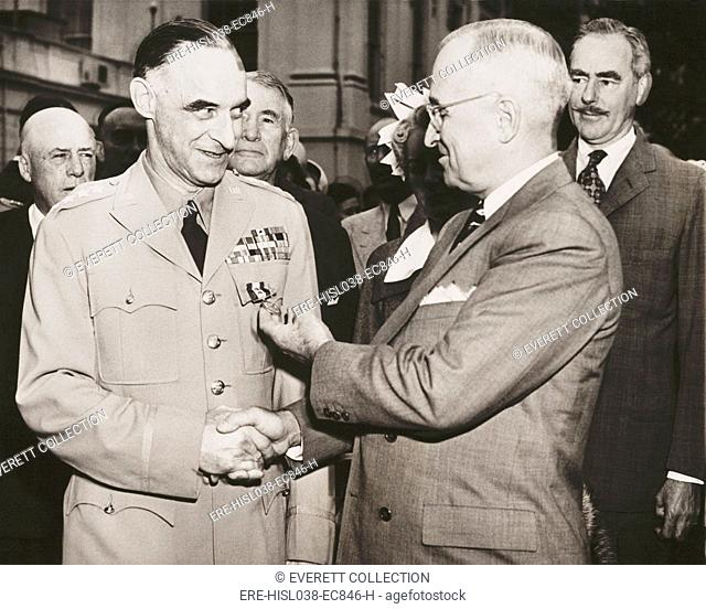 General Lucius Clay after receiving the Oak Leaf Cluster medal from President Harry Truman. Clay orchestrated the Berlin Airlift (1948–1949) when the USSR...