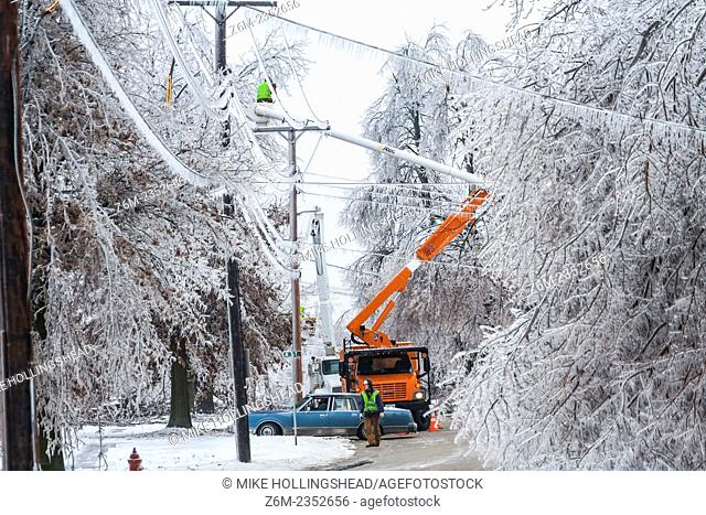 Utility crews make repeairs after a damaging ice storm hits Mound City Missouri, December 10-11 2007