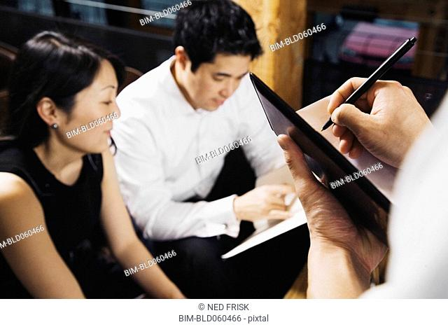 Asian couple ordering food at restaurant
