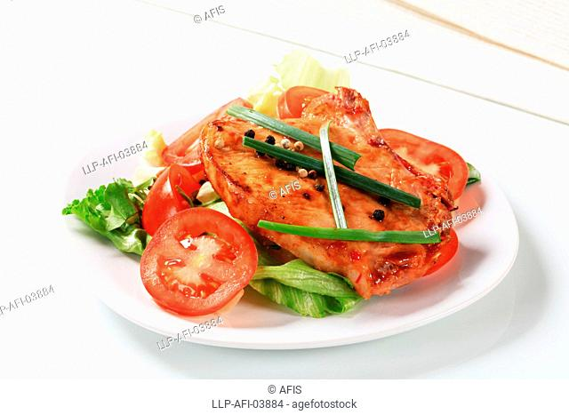 Spicy pork cutlet with fresh vegetables