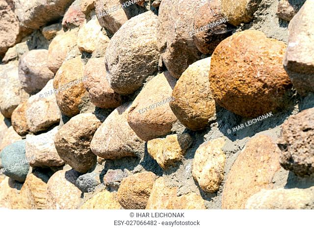 a structure for movement made of stones and boulders. The road, photographed close-up. Small depth of field. Location - Republic of Belarus