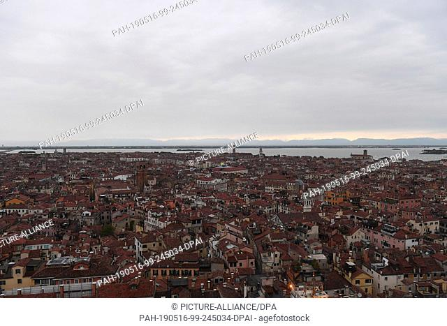 12 May 2019, Italy, Venedig: Northern view from Campanile. From the Markusturm clouds lie over the city of Venice. This is where the Art Biennale is currently...