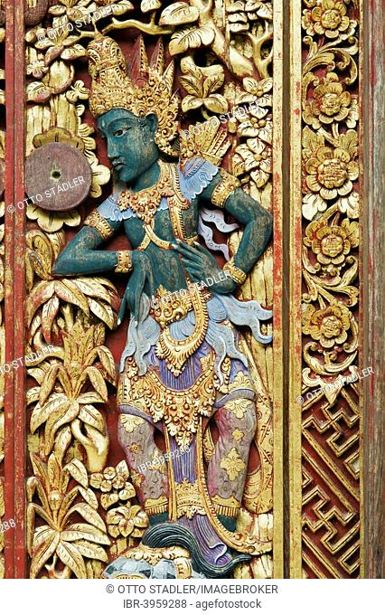 Wooden door decorated with carvings, Neka Art Museum, Ubud, Bali, Indonesia