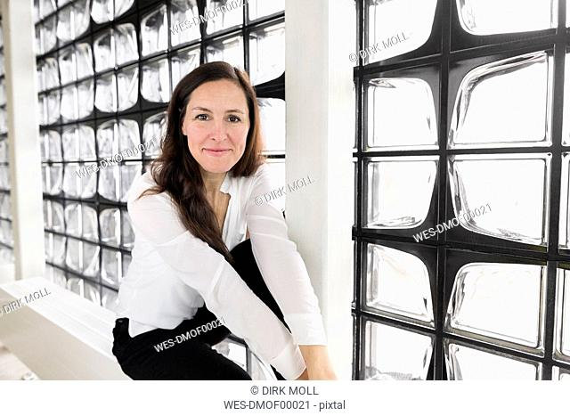 Portrait of content businesswoman