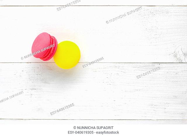 Colorful Macaroons on white wooden background
