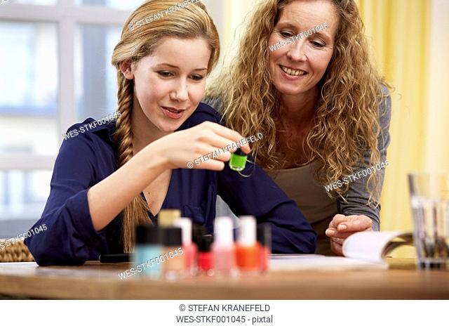 Female teenager choosing nail varnish