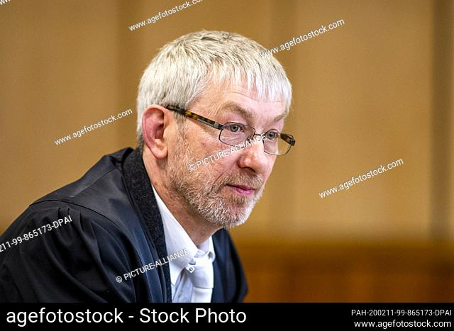 11 February 2020, North Rhine-Westphalia, Hagen: Defense attorney Andreas Trode is waiting for the trial to begin. The defendant is alleged to have stabbed his...