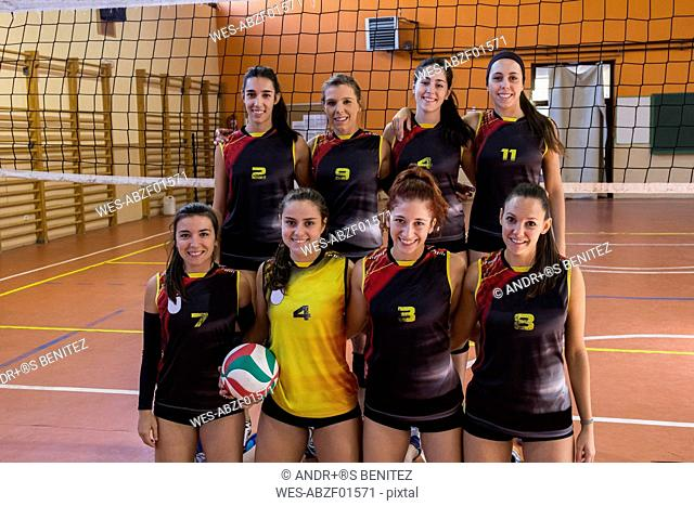Happy female volleyball team