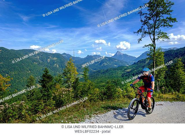 Austria, Tyrol, Juifen, Rotwand mountain pasture, mature men on mountain bike