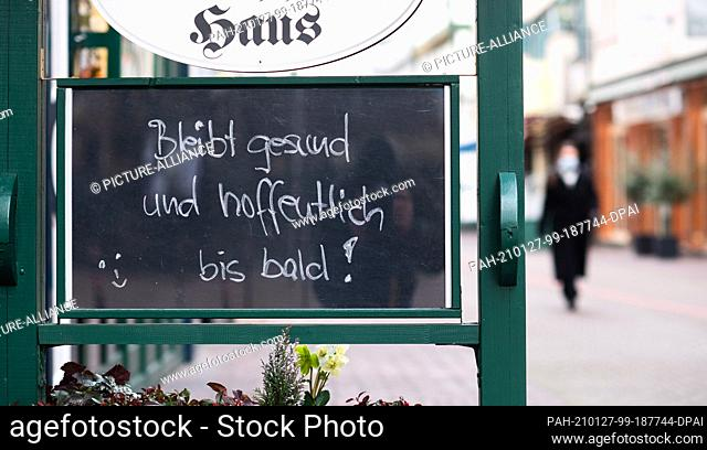 """27 January 2021, Lower Saxony, Hanover: A sign at a closed pub reads """"""""Stay healthy and hope to see you soon!"""""""". The Corona measures and the lockdown in Germany..."""