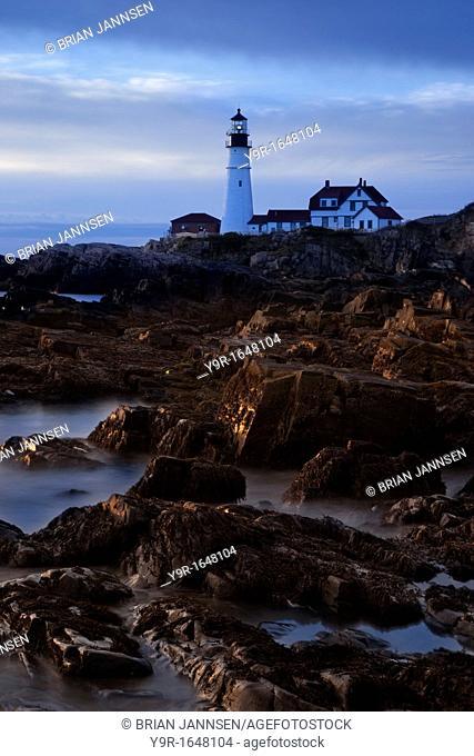Dawn along the rocky cliffs below the Portland Head Lighthouse near Portland Maine, USA