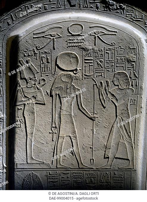 cattle of Amun, depicting the deceased in adoration before the gods Ra-Harakhte, with a hawk's head, and Osiris, limestone, from Saqqara