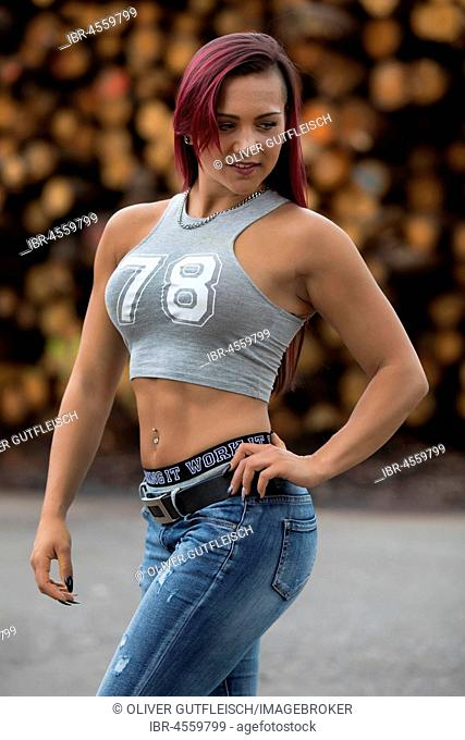 Young woman with jeans and belly top