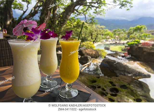 Tropical cocktails (Pina coladas and daiquiri) at the bar of the Hanalei Bay Resort in Princeville on the Hawaiian Island of Kauai, Hawaii, USA