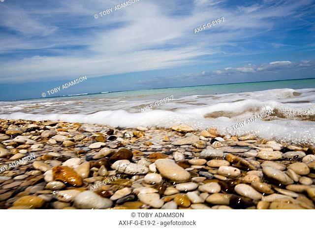 Sea washing in onto sandy beach