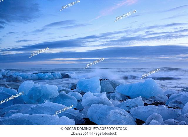 Icebergs from the Jokulsarlon glacial lagoon washed up on a nearby black volcanic sand beach from the North Atlantic Ocean. South Iceland