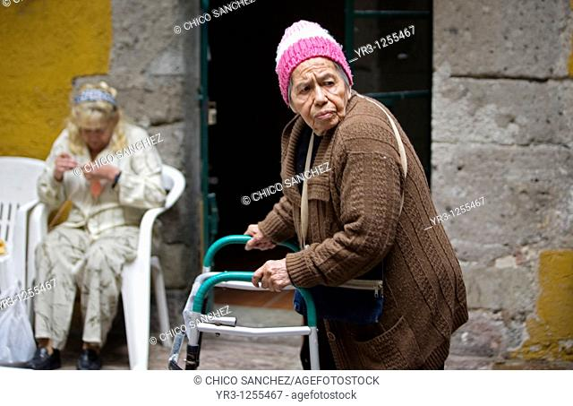 Esperanza Sanchez, 86, walks in the patio of Our Lady of Guadalupe Home for the Elderly, Mexico City