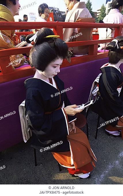 Japan, Tokyo, Geisha Using Mobile Phone, Jidai Matsuri Festival, Sensoji Temple Asakusa
