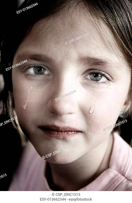 Littel Girl Crying with Tears Rolling Down Cheeks