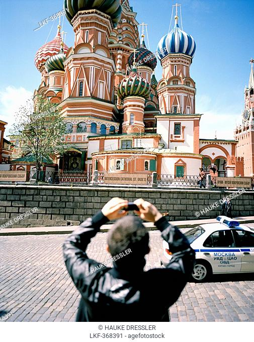 Tourist taking pictures of St. Basil's Cathedral with his cell phone, Moscow, Russia, Europe