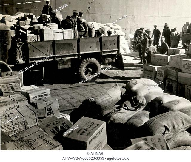 Foodstuffs & Munitions being unloaded in Naples Port from italian troops, Naples, shot 1944