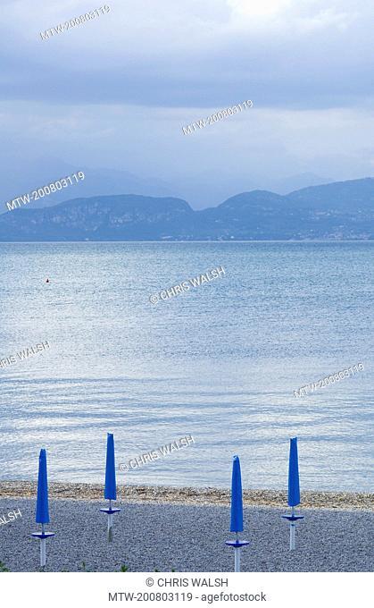 Peschiera lake Garda Italy beach sunshades