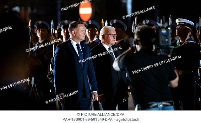 01 September 2019, Poland, Wielun: Federal President Frank-Walter Steinmeier (M) and Polish President Andrzej Duda (L) take part in a military ceremony to mark...