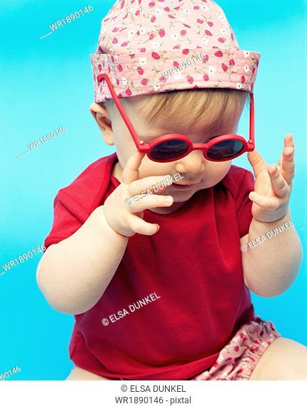 Baby Girl Wearing Sunglasses, Munich, Bavaria, Germany, Europe