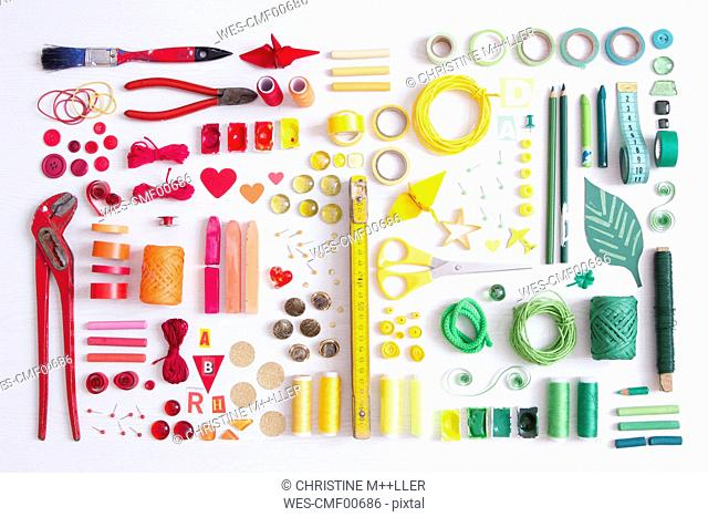 Tools, craft and painting materials on white ground