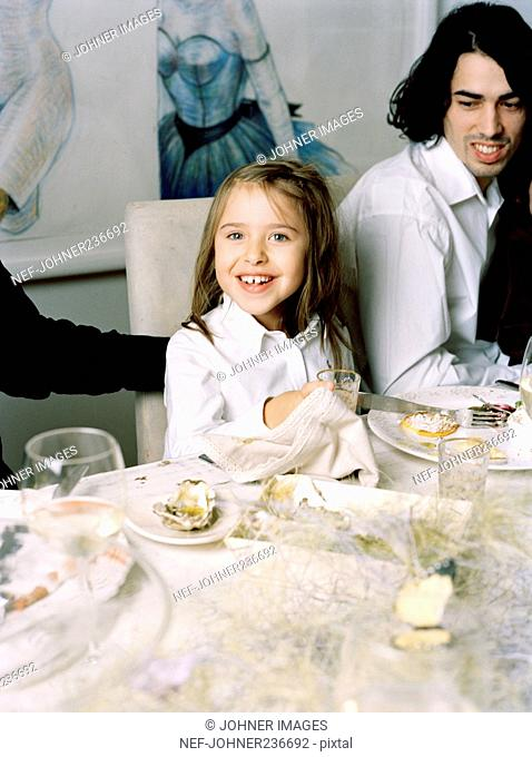 Girl sitting at a decorated dinner table