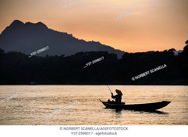 Asia. South-East Asia. Laos. Province of Luang Prabang, city of Luang Prabang, World heritage of UNESCO since 1995. Fisherman on Mekong river