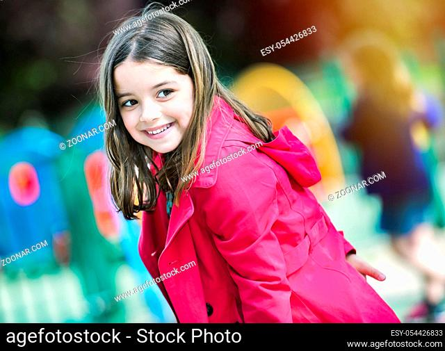 happy cute little girl in playground
