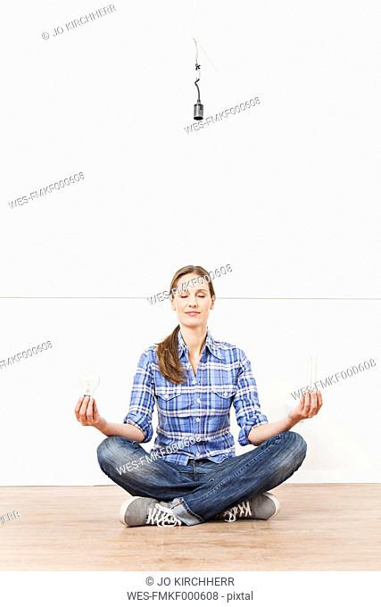 Woman sitting on floor with bulbs
